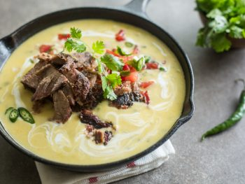 Texas Brisket Queso in a cast iron skillet