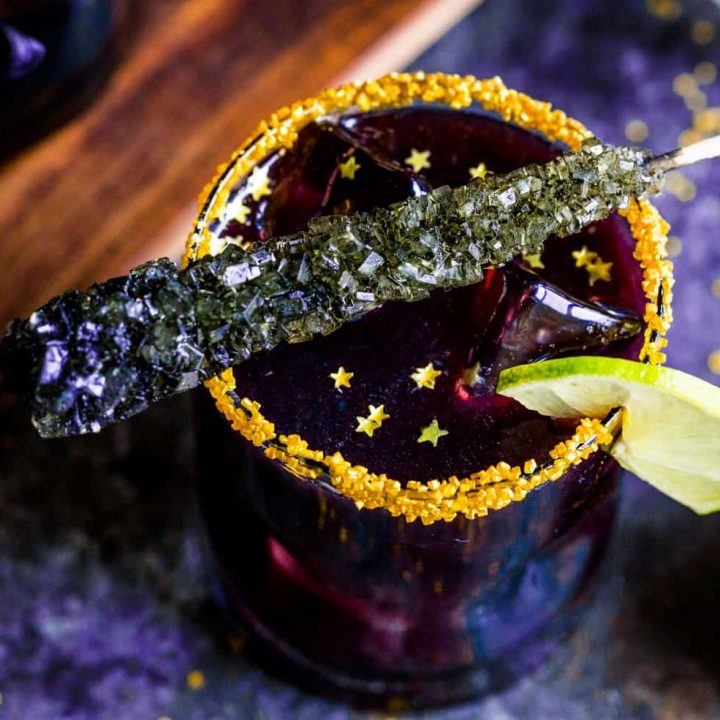 Black Margaritas Recipe - close up with rock candy and gold stars