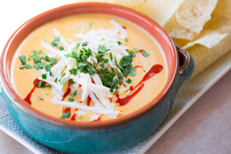 A bowl of Torchy's queso recipe and chips