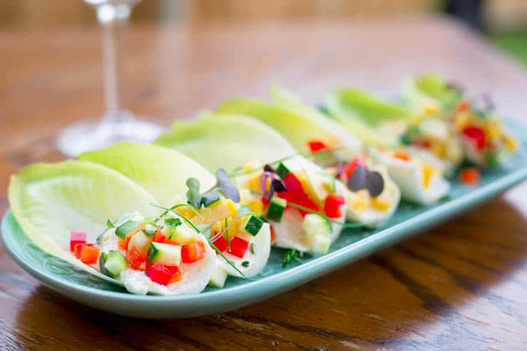 Spring Endive Bites With Boursin Cheese outdoors on a wooden table