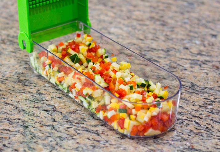 Chopped vegetables chopped in a hand chopper