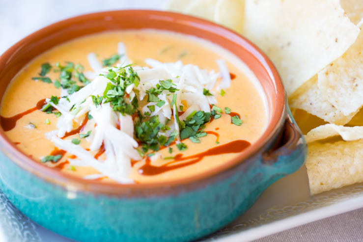 Torchy's Queso in a bowl with chips