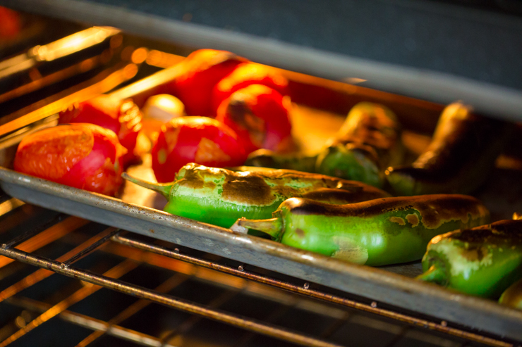 Roasting tomatoes and green chiles