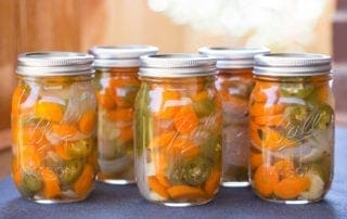 Jars of Texas Escabeche in the sunshine