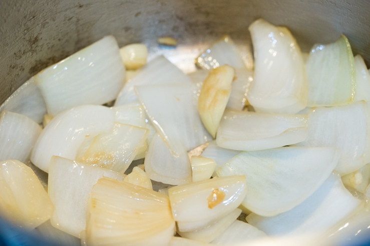 Onions and garlic being sauteed for Texas escabeche
