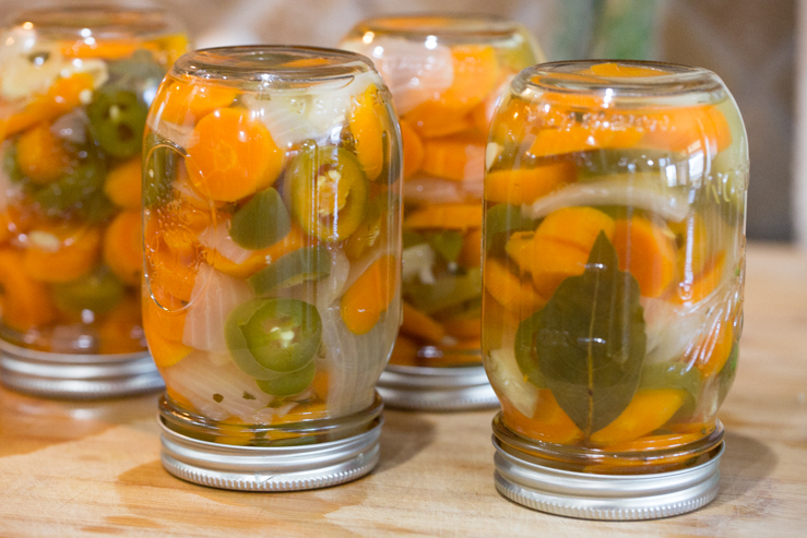 Canning jars of escabeche
