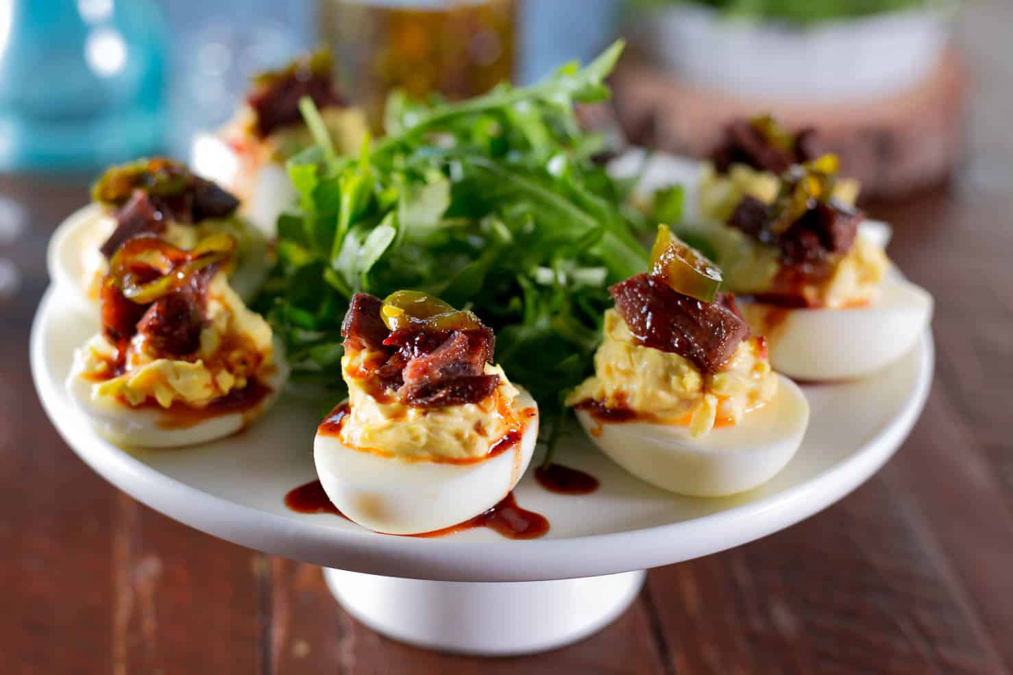 Brisket Deviled Eggs with Candied Jalapeno on a large platter