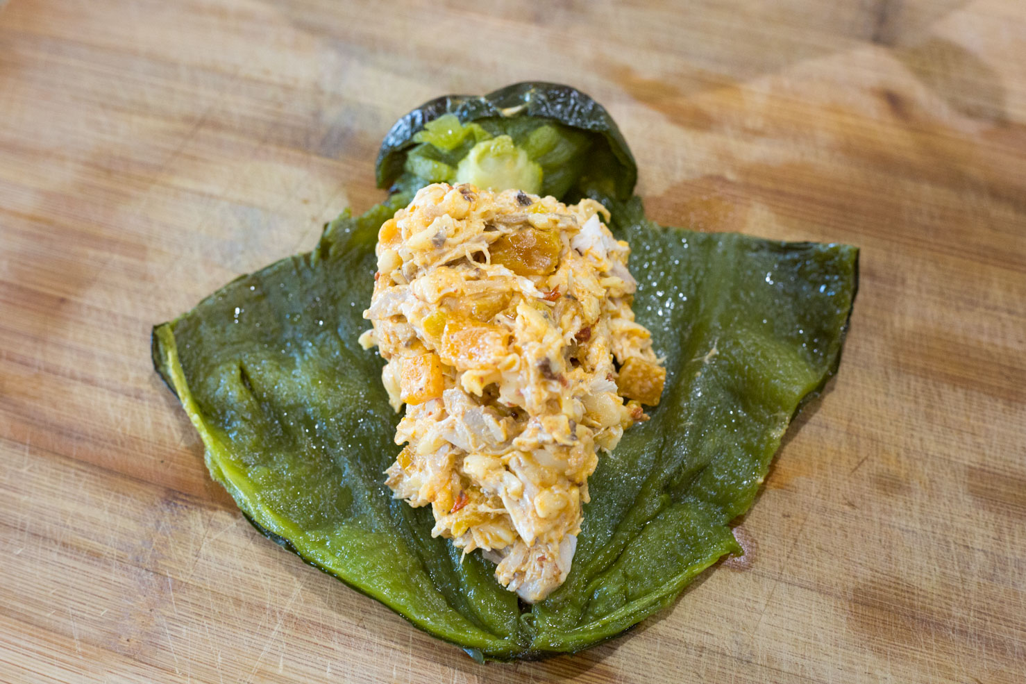 Stuffed peppers- filled with filling, and laid out to demonstrate the T-cut