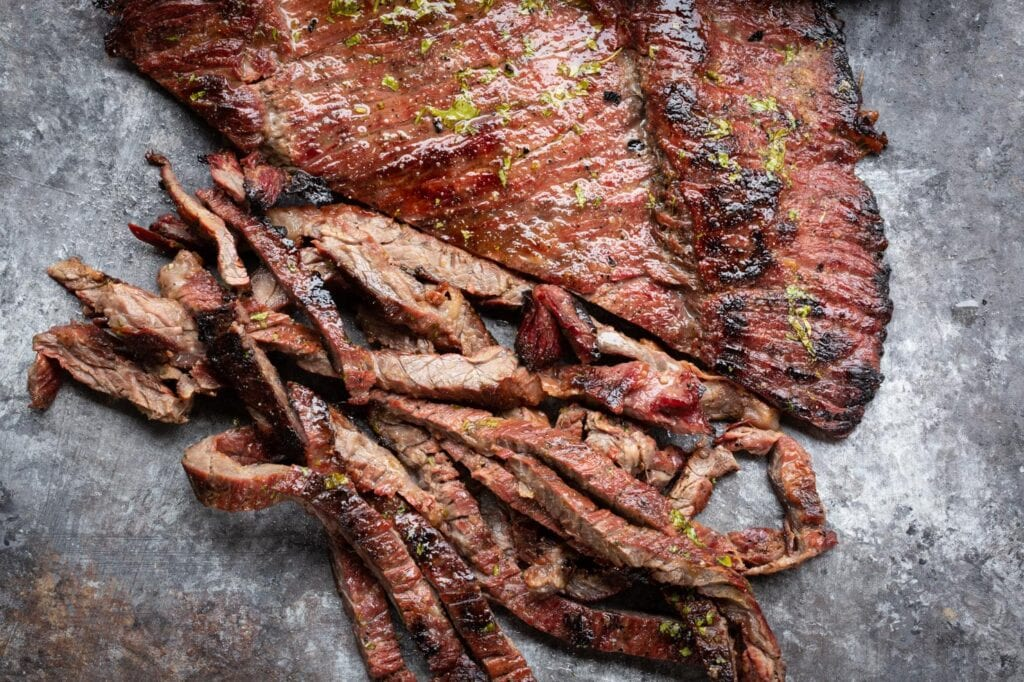 Seared skirt steak fajitas cut horizontally for best results - a demonstration