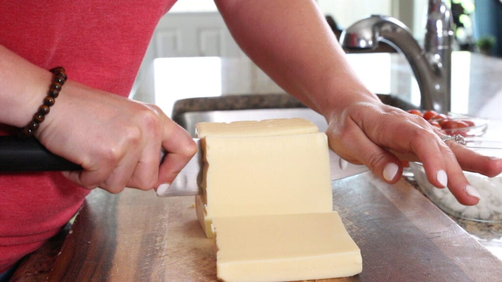 Cutting up white american cheese for the queso blanco dip