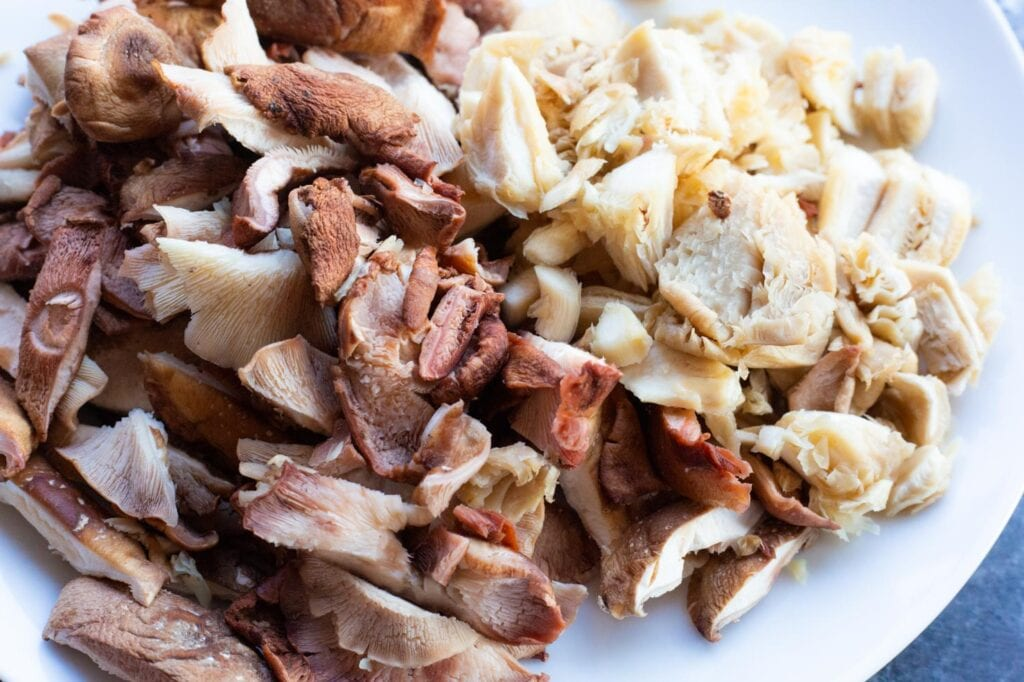 Diced shiitake and oyster mushrooms on a plate