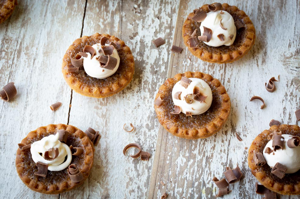 Pecan Butter Tartlets- decorated with chocolate curls