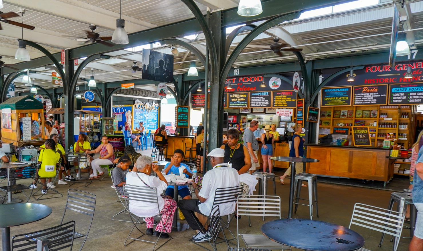 Tables of people at French Market in New Orleans