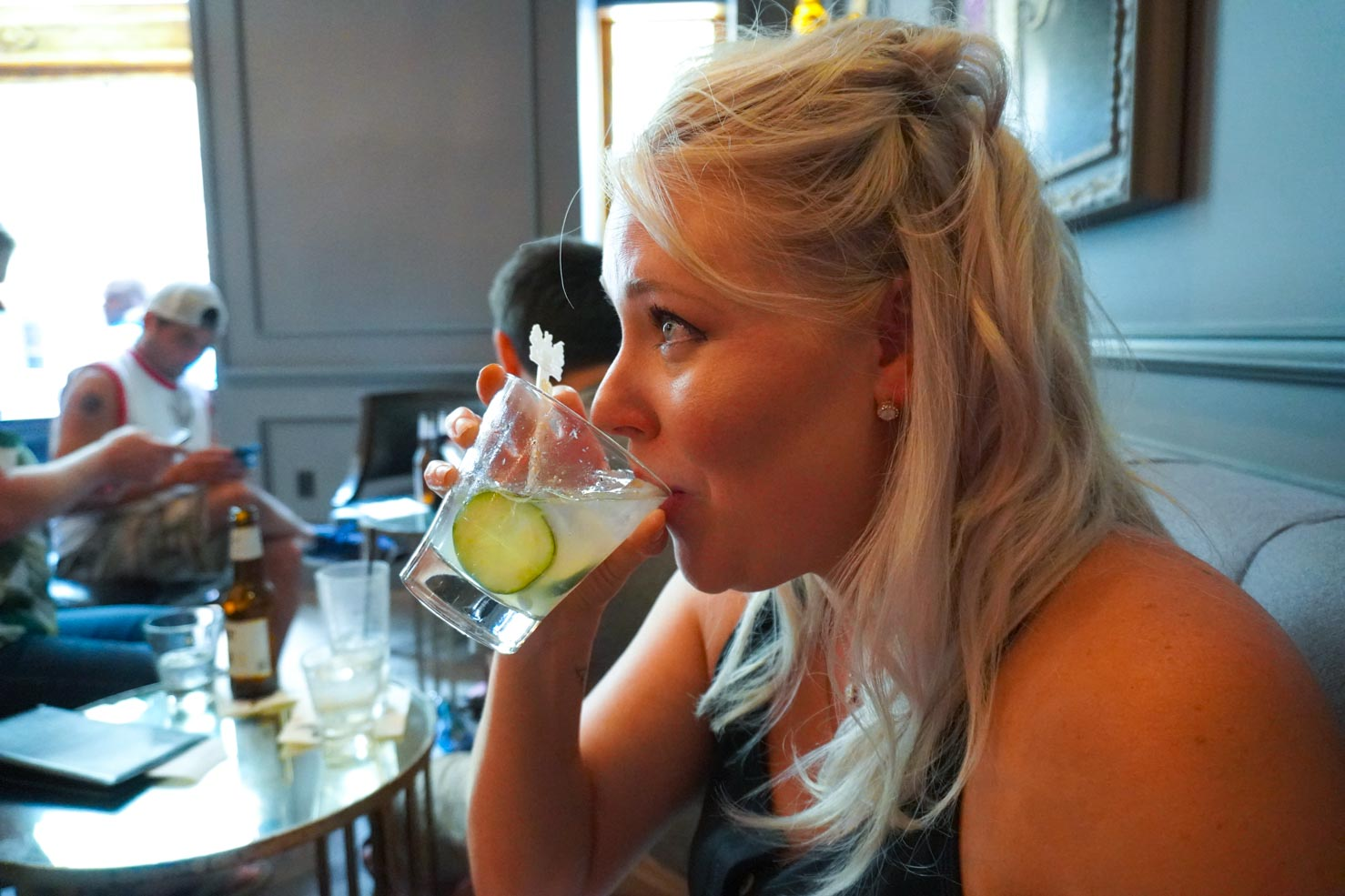 Chef Sarah Penrod sipping a cocktail in New Orleans