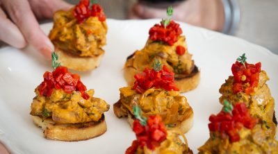 Steak Bruschetta with Piquillo Pepper Sauce served on a plate