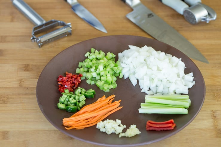 Different styles of chopped veggies, with Japanese knives