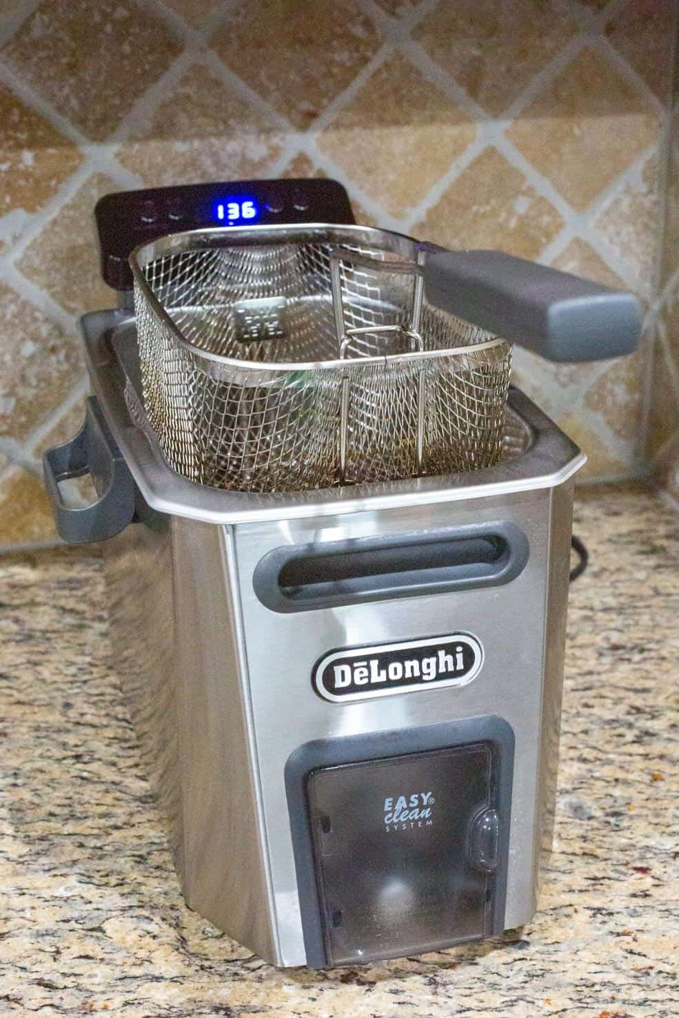 A DeLonghi Fryer, on my countertop, being prepped to fry. (Turned on)