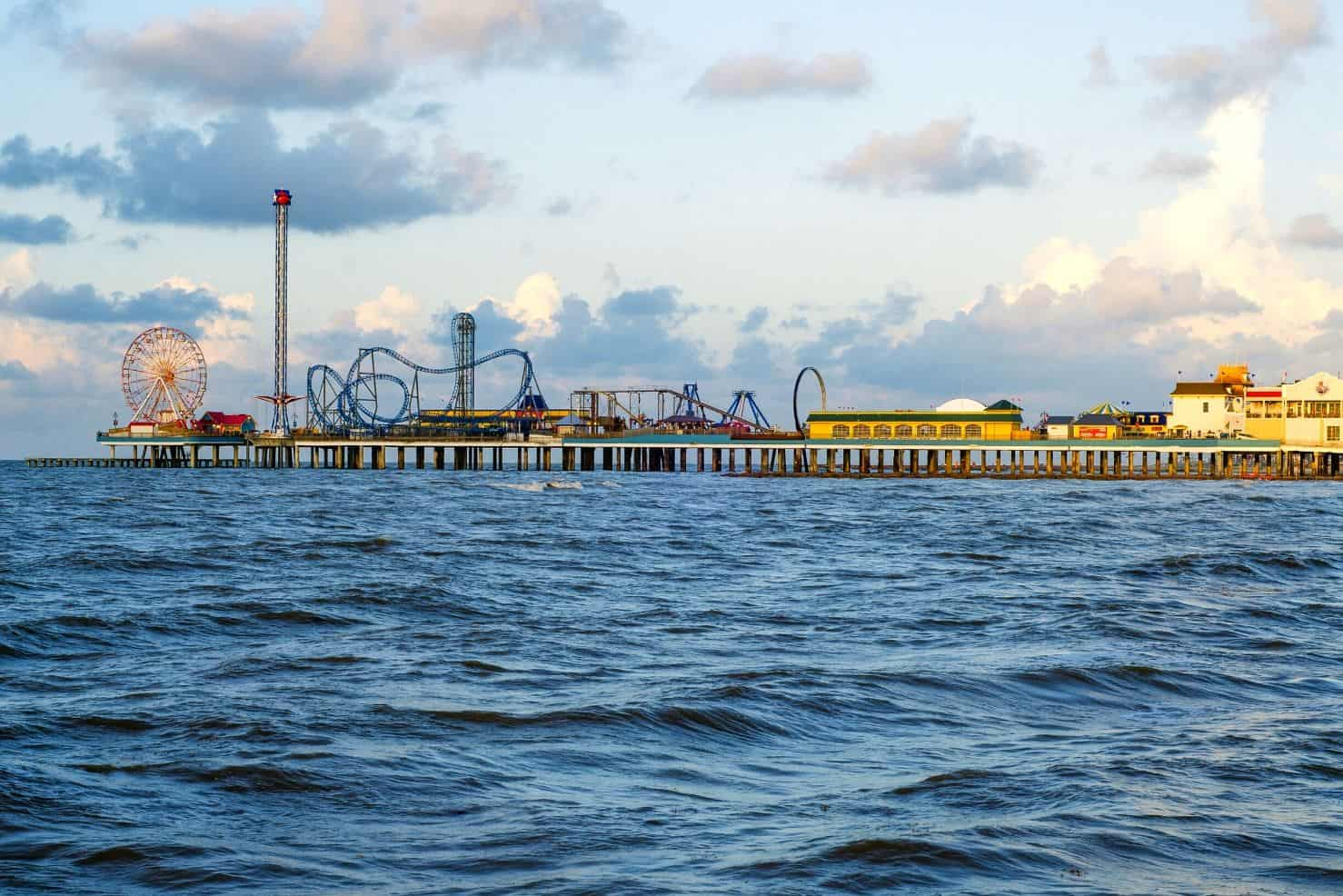 A beautiful blue ocean with the Galveston Pleasure Pier in the background.