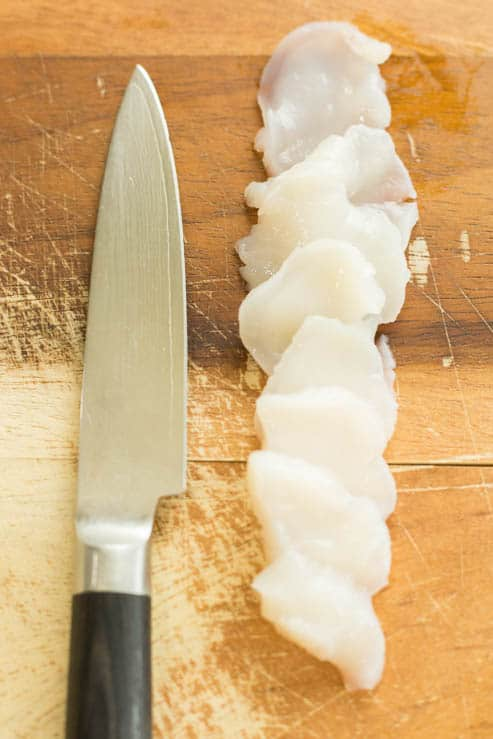Sea Scallops thinly sliced with a knife.