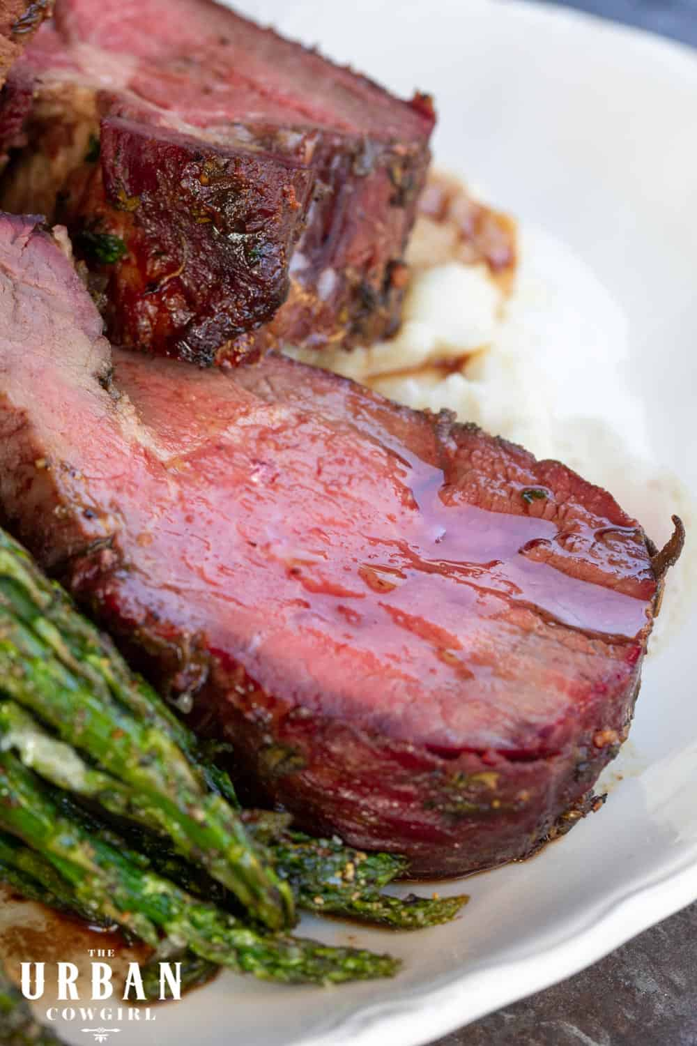 A glistening slab of smoked beef tenderloin with maple shallot juices.