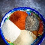 a colorful bowl full of carne asada spice blend