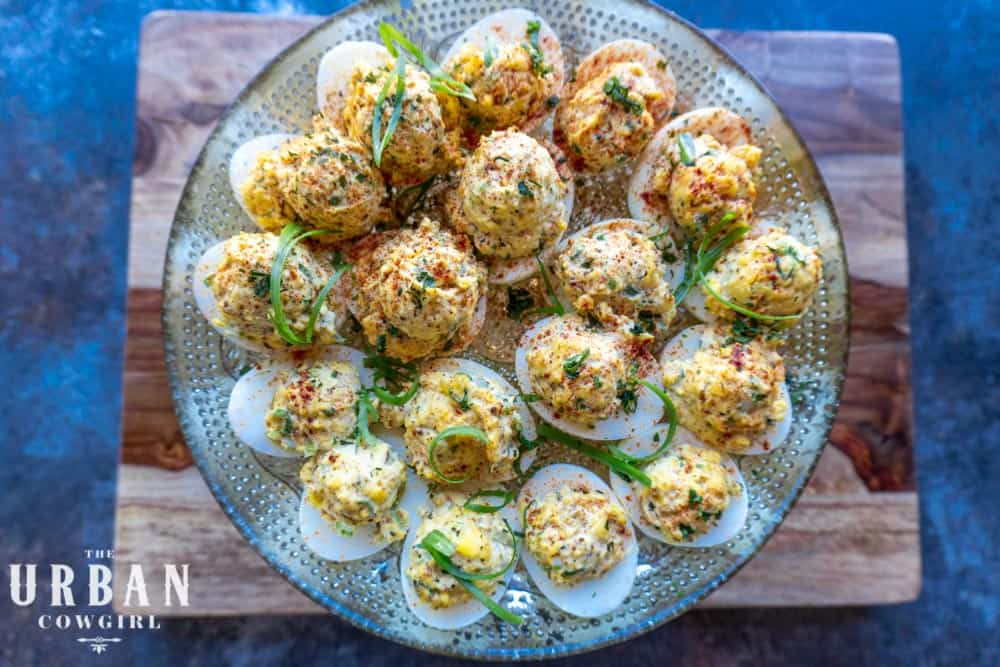 An overhead platter of completed Cajun Deviled Eggs garnished and ready to serve.