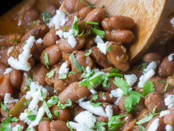 Texas Pinto Beans smothered with cilantro and crema, served out of a crockpot