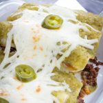 A dish of beef enchiladas with homemade green enchilada sauce