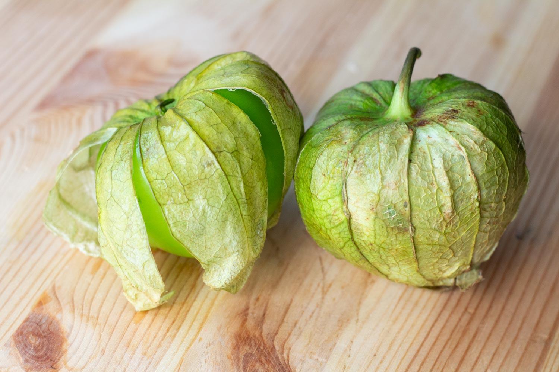 Bright green tomatillos in their husks