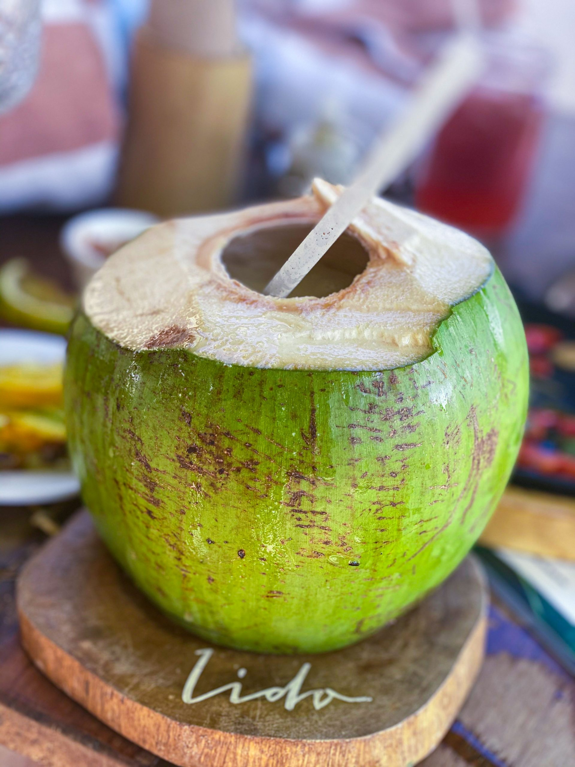 A cocktail in a green coconut