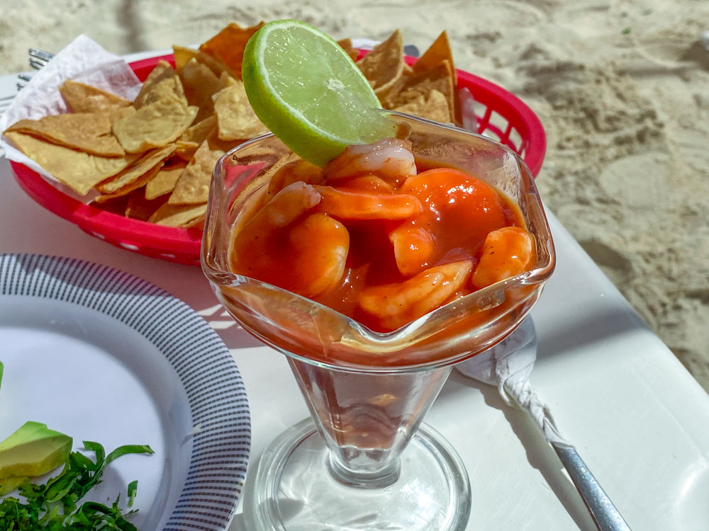 Cocktail de camarones with tortilla chips on the beach.