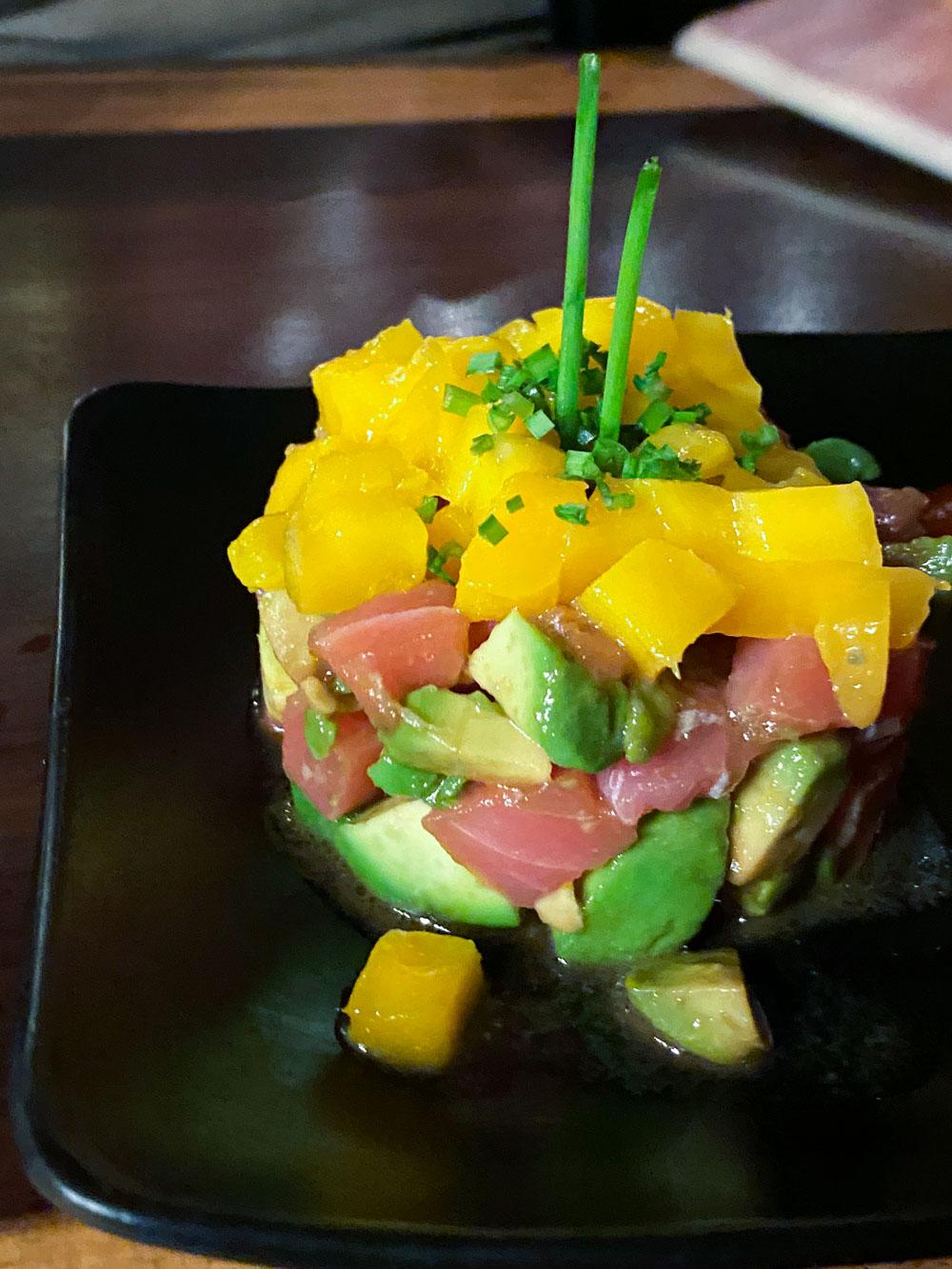 A salmon tartar and mango tower