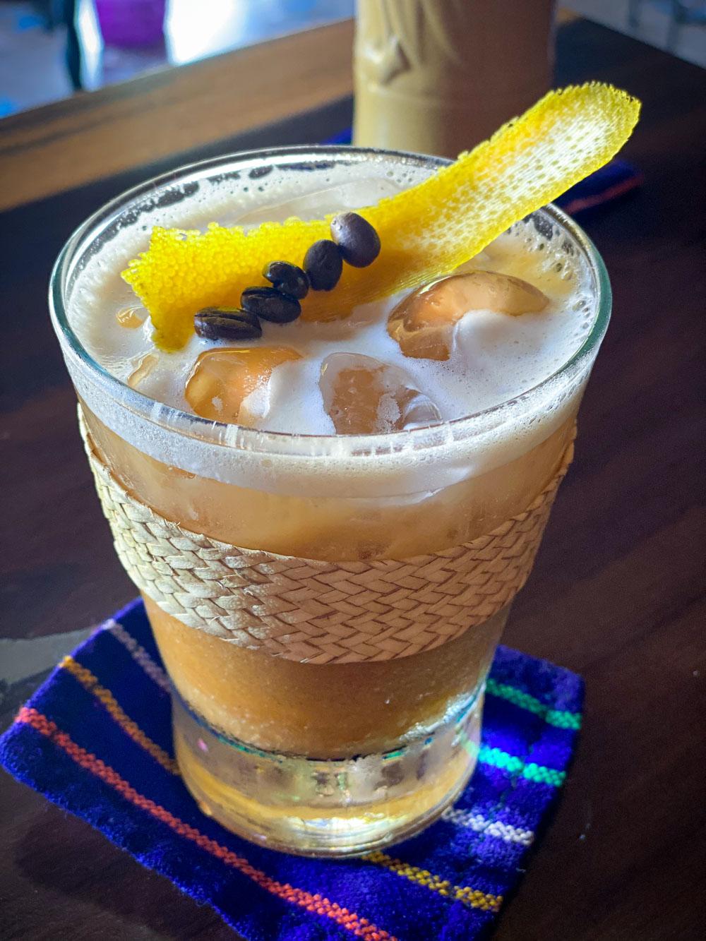 A tiki cocktail with coffee beans at Tiny Tiki Hut