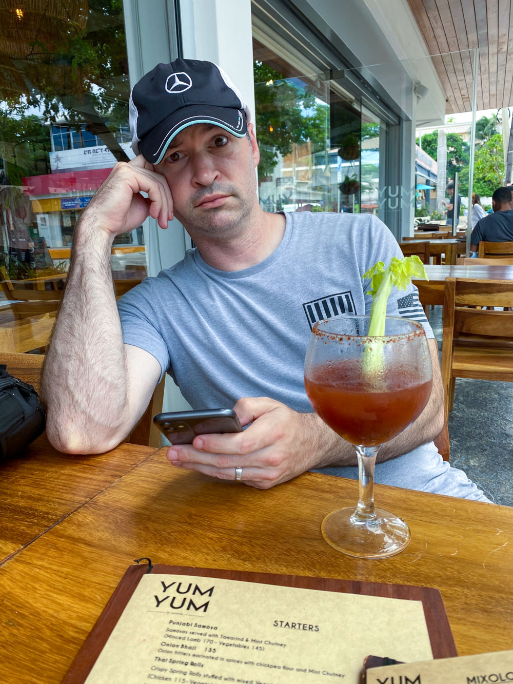 My husband at Yum Yum by George, drinking a Bloody Mary drink