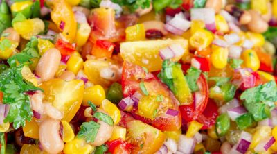 Juicy and colorful marinated veggies in a glass bowl.